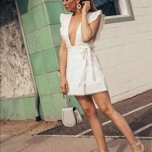 White plunging V wrap dress